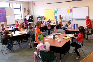 Mrs. Thomson's third graders stay busy on the first day of class at West Grand Elementary & Middle School. West Grand students returned to school on Monday, Aug. 19, 2013.