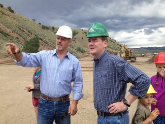 Mill owner Dave Fiala, left, gives U.S. Senator Michael Bennet a tour of the Colorado Timber Resources LLC facility on Monday, July 1, near Parshall.   Leia Larsen/Sky-Hi News