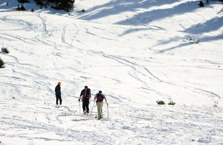 Skiers skin up the east side of Berthoud Pass to get in some early season skiing on Thursday morning, Oct. 24.