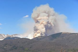 Smoke from the Big Meadows Fire in Rocky Mountain National Park rises from behind Green Mountain on June 11.