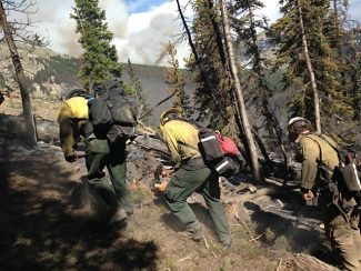 Firefighters from the Uniweep Module dig a fire line on the Big Meadows Fire on June 14.  Photo courtesy of Uniweep Fire Module