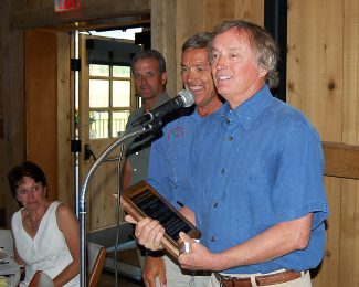 Devil's Thumb owner Bob Fanch accepts his River Conservation Award at the Colorado River Headwaters Chapter of Trout Unlimited annual banquet at Devil's Thumb Ranch on July 17.