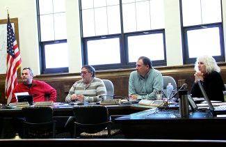In this file photo from March 2014, county commissioners, from left, James Newberry, Gary Bumgarner and Merrit Linke and County Manager Lurline Underbrink Curran listen to questions about ongoing investigations at the Grand County Building Department. The county ma nager is scheduled to leave her post at the county on Sept. 7.