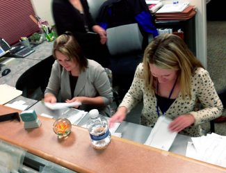 County clerk workers Sheena Darland, left, and Sosey Luke count ballots on election night, Nov. 5.