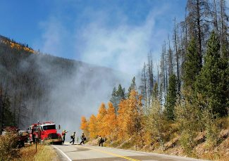 Firefighters respond to a wildfire along Highway 125 in 2010.  Byron Hetzler/Sky-Hi News file photo