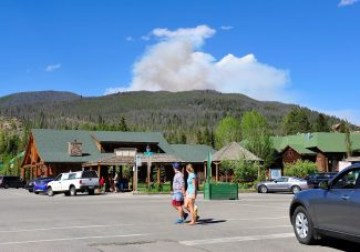 Visitors to Grand Lake look at the smoke rising from the Big Meadows fire on Tuesday afternoon, June 11.  Byron Hetzler/Sky-Hi News