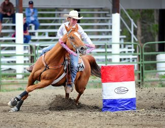 Jacey Murphy turns around the final barrel during the junior portion of the High Country Stampede rodeo on Saturday afternoon, July 13, at the John Work Arena in Fraser.