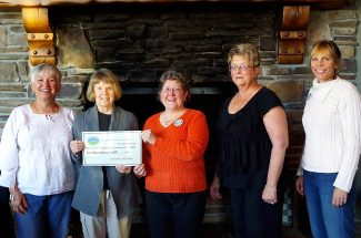 Merilyn Hunter, left, and Nancy Abbott, of the Friends of the Library, award a $1,000 donation to Jill Miles, Rosemary Knerr, and Dede Fay, of the Committee for Sustainable Grand County Libraries. The money was given to help with the campaign concerning a question that will appear on voter ballots in the November election. The donation is intended to help spread the word, through mailings, why a 1.5 mill increase is needed to help keep  libraries operating. The award was presented during a gathering at Brickhouse 40 in Granby on Thursday, Sept. 19.
