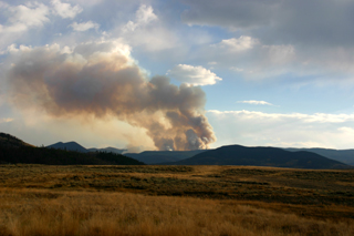 Reid ArmstrongChurch Park fire seen across Linke Ranch in Granby at sunset Sunday, Oct. 3. Weather forecasts call for calm winds and a slight chance of thunderstorms over next few days.
