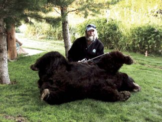 Photo by Jay BerendesHunter Jim Holohan of Fraser poses with a bear he shot on Sept. 27 that he said dressed out at about 600 pounds.