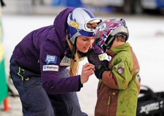 Mar 31, 2011; Winter Park, CO, USA; Lindsey Vonn (USA) autographs the jacket of Spencer Tanenholtz prior to the first run of the womens giant slalom at the U.S. Alpine Championships at Winter Park Resort.