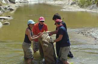 Courtesy photoCleaning up the river is part of the Adventure Education experience.