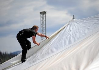 Peter Hartford closes the seams on the roof a tent being set up on Thursday morning in Hideaway Park in Winter Park for this weekend's Blues From the Top festival.   Byron Hetzler/Sky-Hi News