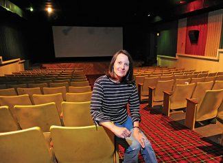 Chris Craig sits in the Silver Screen Cinema that she has operated for the past 34 years.   Byron Hetzler/Sky-Hi News