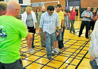New Middle Park High School principal Scott Eldred, right, leads staff members in team building exercises on Tuesday morning in Granby.  East Grand School District teachers returned to work on Monday in preparation for the first day of the classes on Tuesday, September 1.   Byron Hetzler/Sky-Hi News