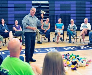 New Middle Park High School principal Scott Eldred, standing, leads a team building exercise with the school staff last week.   Byron Hetzler/Sky-Hi News