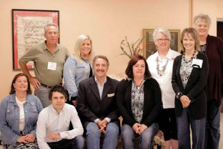 Courtesy PhotoGranby Enterprise Facilitator Patrick Brower, back row, left, attended the Sirolli Fall Forum in Atchison, Kansas, where he met with other Enterprise Facilitators from around the world. He's shown here with some of the forum's attendees and Ernesto Sirolli, the founder of the Sirolli Institute and Enterprise Facilitation.