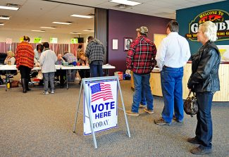 Voters wait to cast their ballots at the polling place at Granby Town Hall on Tuesday morning.   Byron Hetzler/Sky-Hi News