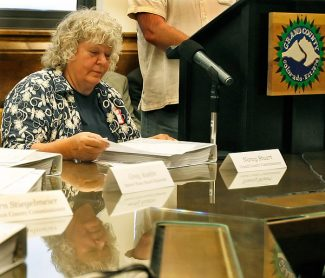 Grand County Commissioner Nancy Stuart prepares to sign the Colorado River Cooperative Agreement in May.  Byron Hetzler/Sky-Hi News file photo