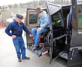 Mike Smith, right, is given an orientation of his new van by Steve Frasier of the Steamboat Springs American Legion on Wednesday afternoon in Hot Sulphur Springs.  Byron Hetzler/Sky-Hi News
