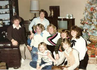 Photo of cousins during a holiday moment  (my cousin Karen in the center)  taken safely away from the fireplace mantel.
