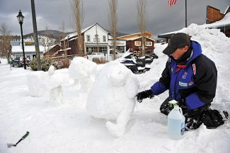 Jimmy Gasner of Rocky Mountain Outfitters works on his snow sculpture on Thursday morning for this weekend's Grand Lake Winter Carnival.   Byron Hetzler/Sky-Hi News