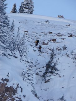 Photo courtesey of George DirthAn Alpine Rescue Team member retrieves a stranded snowboarder near the summit of Berthoud Pass on Saturday, Feb. 2.