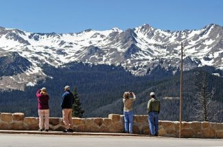 Visitors to Rocky Mountain National Park photograph the Never Summer Range from Farview Curve on Trail Ridge Road on Monday afternoon.  The road opened for the season on Monday--the third earliest opening on record.  Byron Hetzler/Sky-Hi News