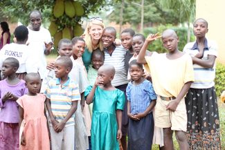 Courtesy photoAn organization based in Kremmling and Uganda, Rural Orphans and Widows AIDS Nework, or ROWAN, is committed to helping villagers in Eastern Uganda. ROWAN co-founder Kelsey Hargadine, of Kremmling, is seen here with residents of the village of Mawanga.
