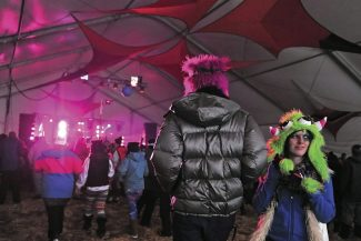 Festival goers take in the music of Gigamesh in the Groove Tent at the SnowBall music festival on Saturday afternoon in Fraser.   Byron Hetzler/Sky-Hi News