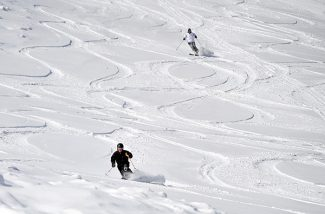 Skiers make turns down the Sleeper trail at Mary Jane on Tuesday morning as skiers and snowboarders enjoyed a powder day following 30 inches of snowfall since Saturday.   Byron Hetzler/Sky-Hi News