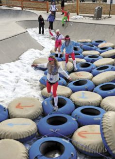 Participants navigate their way through inner tubes during the Winter Park Wipe Out in Hideway Park on Saturday afternoon in Winter Park.  Byron Hetzler/Sky-Hi News