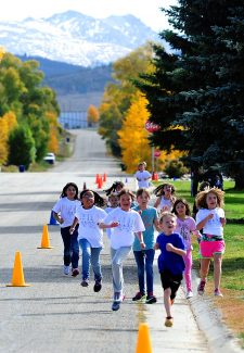 Granby Elementary School third graders participate in a walk-a-thon on Thursday morning, Oct. 3, around Polhamus Park in Granby.  The entire school raised money for the school's PTA through pledges for the number of laps completed.
