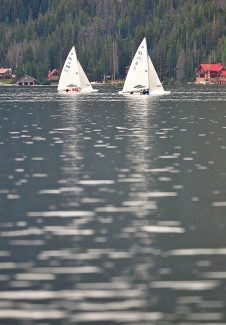 E-class scows race during the Grand Lake Yacht Club Regatta on Wednesday, Aug. 7, in Grand Lake.  Light winds made for slow going for the competitors.
