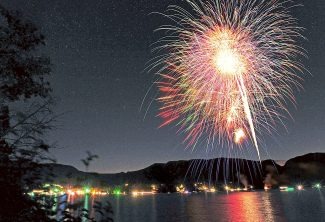 Fireworks light the sky over Grand Lake as part of the town's Constitution Week celebration on Saturday evening, Sept. 21, in this multiple exposure, time lapse image.