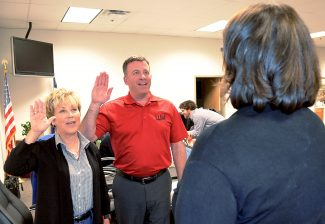 Recently elected Granby Trustees Becky Johnson (left) and Greg Mordini (center) are sworn in by Granby Town Clerk Deb Hess (right) during the Tuesday April 26, 2016 Board of Trustees regular meeting. Both Johnson and Mordini were absent during the previous Board meeting, April 12, when the three other recently elected Board members were sworn in. Granby's municipal election was held on Tuesday April 5.
