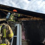 Firefighters from the Grand Fire Protection District conduct overhaul operations on a house in Granby after a structure fire early Thursday morning August 4. The fire caused moderate damage and severely impacted the home's exterior facade.