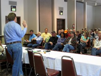 Grand Elk Homeowners Association President Tom Fry addresses Grand Elk homeowners during a meeting last Saturday, April 27, during which homeowners voted support to purchase the Grand Elk Golf Course.