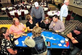 Attendees enjoy an evening of casino games at the Gridiron Bash on Saturday evening, Sept. 7, at the Inn at SilverCreek in Granby.  The event was a fundraiser for the East Grand Gridiron Club.