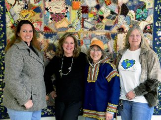 Hot Sulphur Springs Creative Arts Council members, from left, Sandy White, Dawn Mathews, Carolyn Caske and Kathy Knight chat about the arts and Caske's quilt at town hall on Wednesday, Jan. 29. The arts council is working to bring an economic stimulus to Hot Sulphur through a creative arts district.
