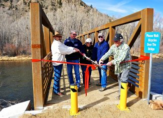 Bob McVay, Hershal Deputy, Christine Lee, Dan Nolan and Andy Miller cut the ribbon to formally open the new bridge over the Colorado River on Saturday, Nov. 9, in Hot Sulphur Springs.