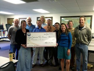 The Headwaters Trails Alliance board and staff were pleasantly surprised during their June board meeting when a last-minute agenda added on by the Grand Foundation turned out to be a presentation of a $10,000 check.