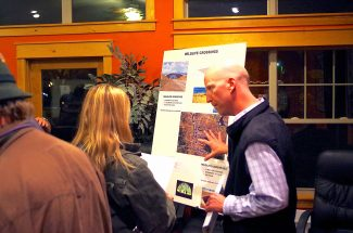 Rob Beck of CDOT, right, discusses the improvements on Highway 9 to Kremmling resident Rebecca Guthrie.