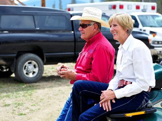 Janet Engel, right, and Dale Sonnek relax prior to the start of the final High Country Stampede rodeo of the summer last Saturday, Aug. 17, in Fraser.  Engel and Sonnek are both retiring from their roles with the rodeo and were recognized during Saturday evening's final rodeo.