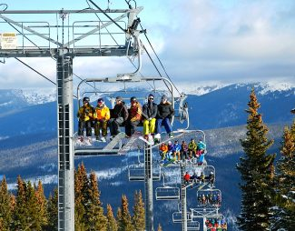 Skiers and riders ride the Super Gauge Express on the opening day of the Mary Jane side of Winter Park Resort on Tuesday, Nov. 26.