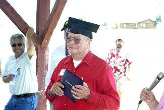 "Ellis ""Lefty"" Newland recieves his diploma at Hot Sulphur Springs Town Park on July 24, 2009. The MPUHS/MPHS Alumni Association presented the diploma to Newland, who missed his graduation in 1948 after enlisting in the military."