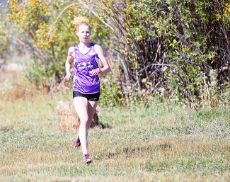 West Grand's Tabor Scholl, running for Middle Park, sprints for the finish of the Middle Park Invitational cross country meet on Saturday morning, Sept. 21, at Snow Mountain Ranch.  Scholl won the girls division in a time of 19:01.16.
