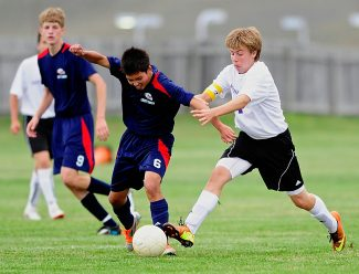 Middle Park's Tyler Wengert, right, battles for the ball with Liberty Commons' Eric Sprackling (6) during a non-league match-up on Tuesday, Sept. 17, in Granby.  Wengert scored the Panthers lone goal in a 3-1 loss.  Middle Park hosts Bennett today at 11 a.m.