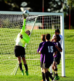 Middle Park goalkeeper Ryan McClain tips the ball away from the goal during Tuesday's, Sept. 24, game against Pinnacle in Thornton.  The Panthers lost 3-0.