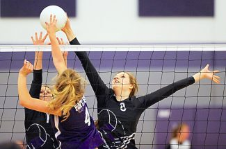 Middle Park's Mary Acord, left, and Evelina Revalaintes (8) block the shot of Lake County's Haley Fresquez (4) during Tuesday's match in Granby.  Middle Park won in three-straight sets 25-8, 25-16, 25-12.  The Lady Panthers travel to Denver to face KIPP at 6 p.m. today.